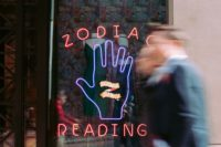 Building With Sign Reading Zodiac Reading