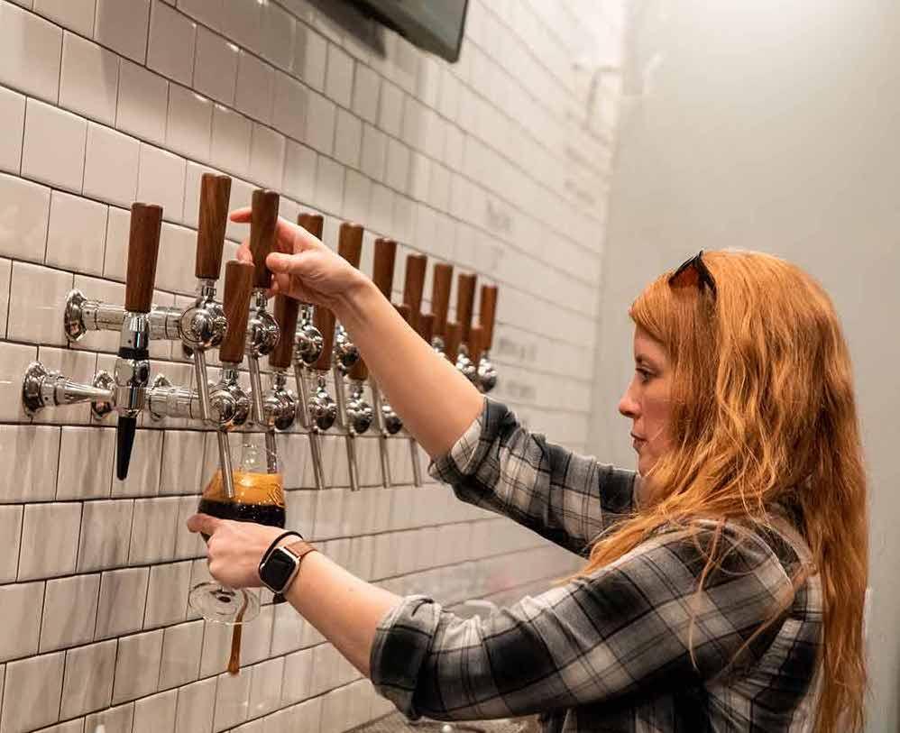 Sara Pouring Beer At Garth's Brew Bar